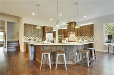 Large kitchen with Thermador appliances, maple wood cabinets and quartz countertops 2113 Glendale Pl, Austin, TX 78704