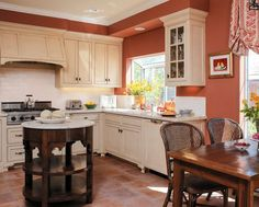 This colour makes a bold statement and looks really good in contrast to the colour of the cabinets. #BoldColours #Red #Orange #Cream #Paint #Painting #KitchenPaint #Décor #Ireland #PatMcDonnellPaints