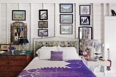 Surrounding the Irvings' bed is a variety of prints, a 19th-century shell mirror and drawings by the artist Eugene Berman. A Moroccan textile — a wedding present from Eric Boman and Peter Schlesinger — covers the lampshade. (Photo: Simon Watson)