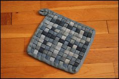 Denim Rug.  Upcycle old jeans.  This is for a potholder, but wonder if it would work for a rug?  http://www.barefootkitchenwitch.com/the_barefoot_kitchen_witc/2013/02/woven-denim-potholder-tutorial.html