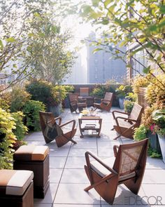 Urban Garden Design Midcentury teak-and-cane furniture with cushions covered in Perennials fabrics fill the spacious terrace of this duplex apartment. - No matter how small, no matter how simple, a garden or terrace is the ultimate city luxury. Outdoor Tiles, Outdoor Rooms, Outdoor Gardens, Outdoor Living, Outdoor Decor, Rooftop Gardens, City Gardens, Outdoor Pergola, Backyard Patio