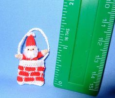 Santa down the Chimney . Knitted by Jill Rothwell
