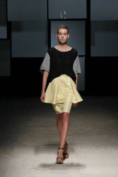 Interesting take on the peplum and pencil skirt look.
