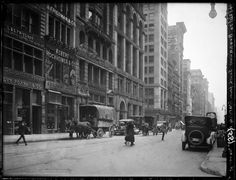 Broadway Series. View of the East side of Bway looking south from Waverly Place. Three blocks are shown below. East 4th, Great Jones and Bond Street. No. 708 is shown at left of picture. A great whole Date: April 20, 1920