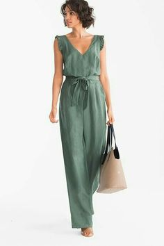 This jumpsuit with frilled straps and tie belt brings a feminine stylish note to an outfit Mode Abaya, Outfit Trends, Jumpsuit Dress, Summer Jumpsuit, Strapless Jumpsuit, Linen Dresses, Jumpsuits For Women, Casual Looks, Fashion Dresses