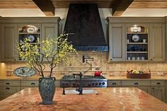 Country-style kitchen in a Colorado Rockies lodge.   Stylish Western Home Decorating