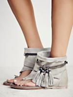 Marlo Boot Sandal   Tribal-inspired boot sandals featuring rope fringe detailing and open-toe design. So-soft suede shaft creates a worn-in, distressed aesthetic.
