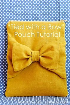 """Tied with a Bow"" pouch.  So ingenious how she made the bow!  I could use my purple linen to make a laptop or nook case, perhaps?"