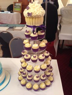 Purple and white wedding cupcake tower. Topped with matching giant cupcake.