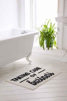 Taking Care Of Business Bath Mat - Urban Outfitters