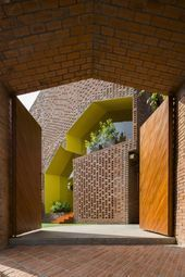 the 'chuon chuon kim 2 kindergarten' school designed by kientruc o in vietnam is built almost entirely of exposed brick with pops of vibrant color. Kindergarten Architecture, Kindergarten Design, Kindergarten Drawing, Brick Roof, Brick Facade, Brick Houses, Brick Design, Facade Design, Homemade Wall Decorations