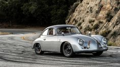 """Porsche restomods can be a touchy subject amongst purists, but Burbank, California's Rod Emory is considered one of the best -- despite his enthusiasm for non-original additions. Emory Motorsports' custom 356s, in particular, are in high demand -- Jay Leno is a notable customer -- and it's not hard to see why. Case in point is the gorgeous 1959 Porsche 356S """"Outlaw"""" (seen here) that the car company recently revealed, featuring rally-style seating and modern performance upgrades while…"""