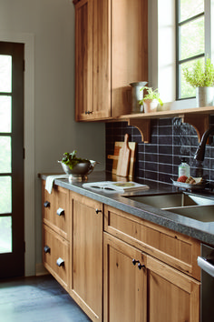 #Kitchen #cabinetry #ideas and #inspiration! Be inspired by these #rustic #farmhouse kitchen #cabinet #designs as you plan for your #home #remodel & #renovation. This rustic #hickory and #black kitchen brings the warmth of the outside in.
