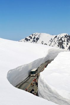 Snow Canyon, Toyama, Japan...to me, this road looks so dangerous. That snow wall could collapse at any time...especially on a slope like that