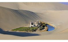 Crescent Lake: A Desert Oasis in Dunhuang, China - via Urinal Cakes on Reddit via Twisted Sift