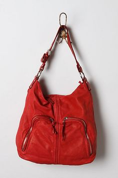 Chris Kon's crimson hobo is the perfect on-the-go bag - just toss in keys, sunscreen, your Red Dot Jambox, and you're set!