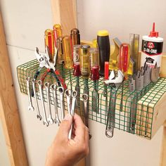 woodworking tools Hardware Cloth Tool Roost — The Family Handyman - Store just about every hand tool you need on a strip of vinyl-coated wire mesh hardware cloth. Make a frame from a scrap of plywood.