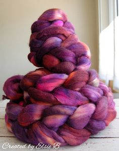Hand dyed soft Merino / Alpaca / Silk combed top Good for spinning, felting, blending, knitting, weaving & petting upon occasion. Colors: Purple, Plum, Neon Orange, Neon Pink, Grey 4 oz   DETAILS 50% Merino, 30% Alpaca, 20% Tussah Silk Micron count: 21 How soft is it? Wear it next to skin This listing is for one (1) of 4 braids in this dye lot currently available, please purchase enough for your project.  **This is a one of a kind result and not repeatable**  Dyed with Jacquard, Dharma…