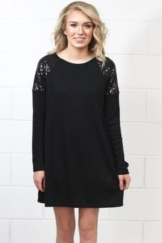 Long sleeve, hacci sweater dress with sequin shoulder panels. Super cute and festive. Very soft to the touch. Swing style dress.