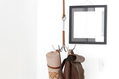 This clothing hook hangs from the ceiling, so you can use to hang up your clothes without taking up too much space. I was inspired by horse tack used to hang up saddles in barns, and the final design looks like a cool ninja-style grappling hook.  You can hang this slim and minimal clothing hook anywhere you need a bit of extra organization, like a bedroom or a front entrance. It also adds a nice slick design element to your space.  #hook #grapple #ClothingHook