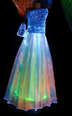 Wedding dresses made at LumiNight USA are very unique and are custom made by one of our designers either in Italy or Seattle, Washington. The cost of fiber optics are very expensive, so an entire wedding dress made from LumiNight USA Light Up Dresses, Light Up Clothes, Pretty Dresses, Beautiful Dresses, Light Dress, Vestidos Neon, Prom Dresses, Formal Dresses, Wedding Dresses