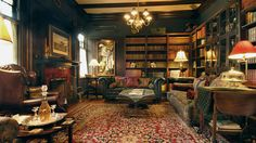 Classic library- love the green walls,mix of fabric and leather, beautiful rug, lots of seating....what's not to love?