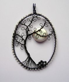 The Witching Hour by Louise Goodchild - Craft wire, seed beads, and a freshwater coin pearl. The frame is actually midnight blue wire, wrapped with pearlescent seed beads to represent stars. The tree is black wire. Wire Wrapped Jewelry, Metal Jewelry, Beaded Jewelry, Handmade Jewelry, Wire Pendant, Pendant Jewelry, Wire Crafts, Jewelry Crafts, Bijoux Fil Aluminium