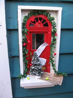 Fairy door. One of many located outside downtown businesses, Ann Arbor Michigan. Photograph found at Urban Fairies, by illustrator Jonathan B. Wright.