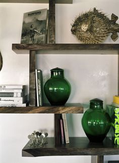 Elegant vintage decorative accessories are a signature Novogratz touch............like this idea.......but need white shelves, shabby chic maybe
