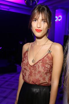 Jeanne Damas in Gucci with a bold lip and pulled back hair.
