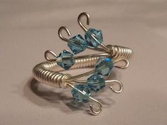 Wire Wrapped Swarovski Crystal Ring; i think you can use the coiling gizmo to create the base, then form as needed (but not sure)