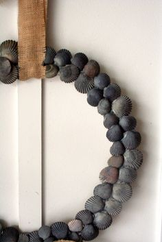 How to Make a Shell Wreath {wreath} - Home Stories A to Z.     I think this is also equally workable into a mirror or mirrored candle holder. Vio~