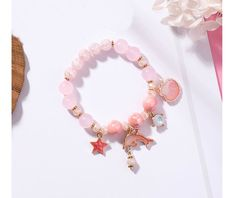 Pink Marine Dolphin Shell Flower Beads Beach Holiday Charm Bracelets sold by Crawon. Shop more products from Crawon on Storenvy, the home of independent small businesses all over the world. Little Girl Jewelry, Girls Jewelry, Handmade Bracelets, Beaded Bracelets, Charm Bracelets, Silver Charms, Sterling Silver Bracelets, Presents For Wife, Birthstone Charms
