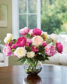 "Peonies have long been a favorite to cut from the garden. Now they   can be an everlasting beauty in your home, minus the pesky black ants.   This silk beauty is arranged in an 8"" diameter ball vase with our   crystal clear acrylic water. It is a definite ""Show Off"" centerpiece   that is sure to bring a smile to friends and family."