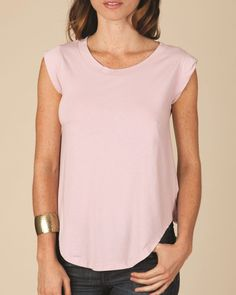 Flattering cap sleeves and scoopneck make this T-shirt a standout. Alternative 4013 - Ladies' Cap Sleeve T-Shirt is made of 3.7 oz., 100% combed ringspun cotton, 40 singles. The design features include feminine cap sleeves, double-needle stitching and rounded bottom hem.
