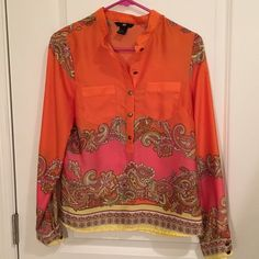 H&M classy print H&M classy print shirt main color is orange size 4   100%Polyester . No damages in it , it doesn't fit me anymore. Fits like a S or M and the material doesn't stretch. The front buttons where very gold when I got the shirt and now they are a little darker but still gold H&M Tops Button Down Shirts