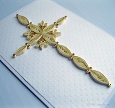Quilled Cross with touches of gold.