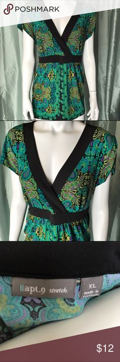 💕 2/$15: Apt. 9 colorful patterned blouse This stretchy top is blue, green, purple, and black. This shirt has lovely jewel tones and is so elegant. Wrap style at the bust. This top is pinned to the mannequin but indeed fits XL or maybe even a size bigger. Very pretty paisley style pattern on this blouse. Short sleeve v-neck shirt is wonderful for many occasions. Apt. 9 Tops Blouses
