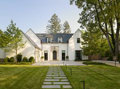 In the exterior, traditional forms are interjected with modern twists and details, creating a home that feels warm and familiar yet clean and crisp at the same time.