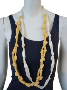 Designer: Once More    Item: Necklace    Composition: 100% Cotton    Made in Italy    Description:    Necklace in fabric with knots in different colours      > Need Help?    Price $ 84.00 $42.00    Discount: -50%