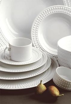 The refined beauty of natural pearls informed this elegant white porcelain dinnerware from L'Objet. Plate measures in diameter Limoges porcelain Dishwasher safe Farmhouse Dinnerware, White Dinnerware, Porcelain Dinnerware, Ceramic Tableware, Dinnerware Sets, Kitchenware, White Dish Set, White Desserts, Pink Christmas Decorations