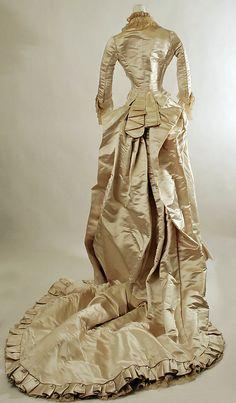 Silk satin wedding dress with lace trim (back), American, ca. 1882.