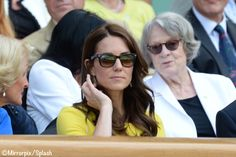 We saw the return of Kate's Ray Ban Wayfarer sunglasses. It looks like it could be one of her folding pair, but I need to find a better photo to be sure which style she is wearing. DAME MAGGIE SMITH BEHIND HER