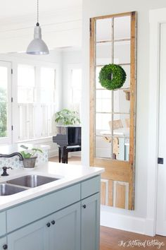 The Lettered Cottage Kitchen | French Door Mirror | Boxwood Wreath | Heather Gray Island | Gray Owl Walls Lightened by 50 Percent