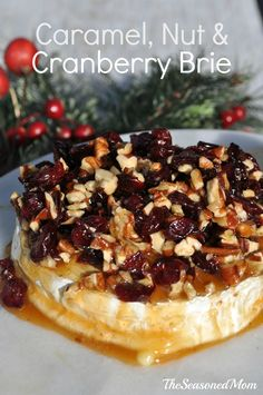 This Caramel Nut and Cranberry Brie Appetizer is the perfect combination of oozing, creamy cheese, sweet fruit, and crunchy pecan topping. Best of all, the crowd-pleasing dish is ready after just 1 minute in your microwave!