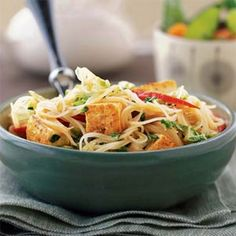 Curried Noodles with Tofu Recipe Main Dishes with rice sticks, light coconut milk, sugar, low sodium soy sauce, fresh ginger, minced garlic, green curry paste, salt, cooking spray, extra firm tofu, red bell pepper, chinese cabbage, green onions, chopped fresh cilantro