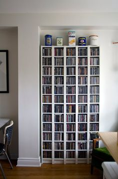 House Tour: A Colorful, Thrifty Toronto Home Vinyl Storage, Dvd Storage Shelves, Media Storage, Living Room Storage, Interior Design Living Room, Multipurpose Guest Room, Music Studio Room, Small Space Interior Design, Bookshelves