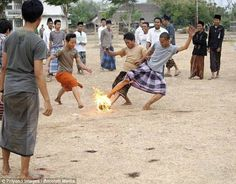 Indonesian ordinary boys are not interested in domestic football, they want something hot. So they are playing … burning coconut! Extreme Sport.
