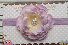 Light purple, lavander flower headband- newborn, infant, child, teen or adult sizes. $11.50, via Etsy.