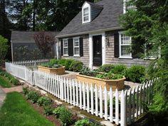 Existing White Picket Fence Encloses Raised Vegatable Garden - Nilsen Landscape Design in Boston, MA